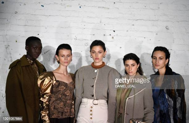 Models pose for a pictyre before presenting creations by fashion house Rejina Pyo during the catwalk show for their Autumn/Winter 2020 collection on...