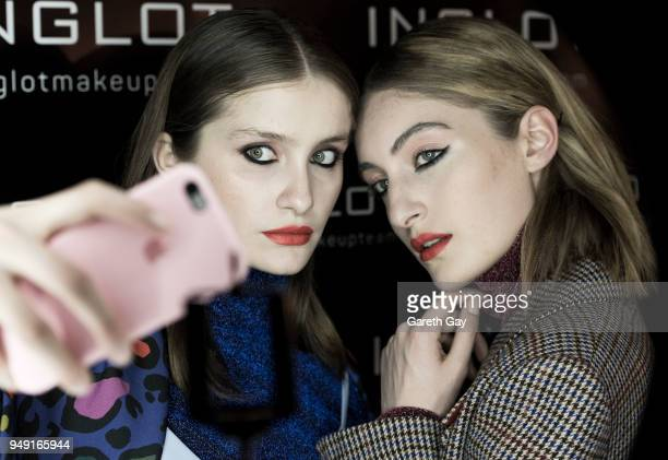 Models pose for a selfie backstage before showcasing designs by Sayya during day 2 of Tbilisi Fashion Week at the Tbilisi Balneolical Resort on April...