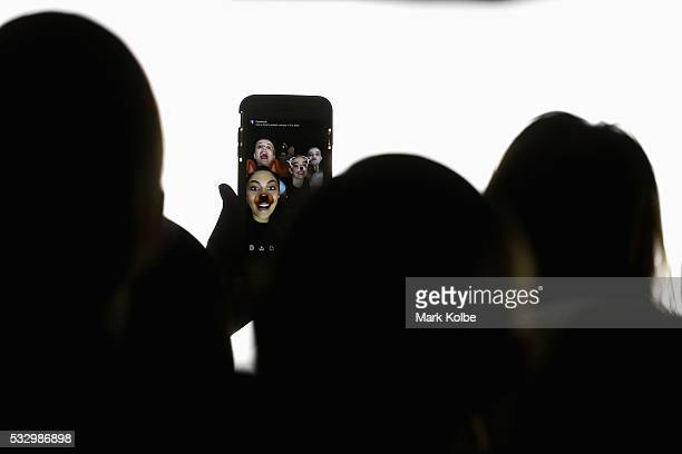 Models pose for a snapchat photo on their mobile phone as they wait for preshow instructions during rehearsal ahead of The Innovators Fashion Design...