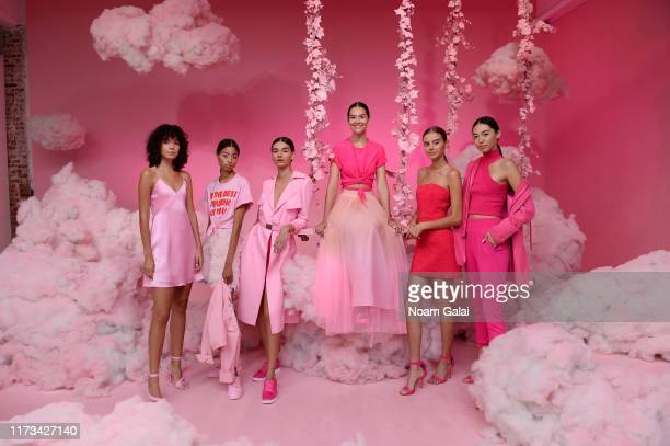 Models pose for Alice + Olivia By Stacey Bendet Presentation during September 2019 - New York Fashion Week: The Shows on September 09, 2019 in New...