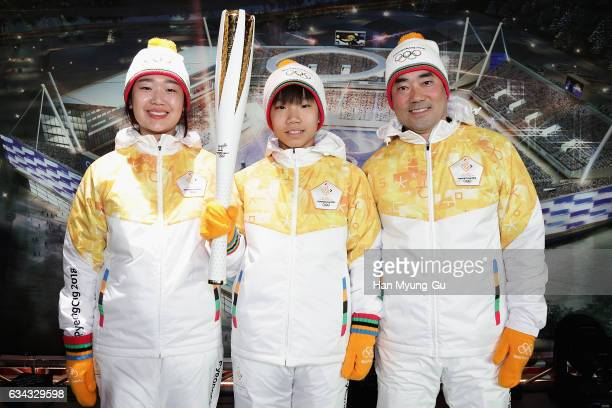 Models pose for media as the Unveiling Ceremony of the Olympic Torch and Uniform at the PyeongChang 2018 One Year to Go Ceremony at Gangneung Hockey...
