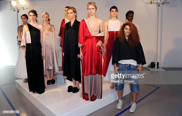 Models pose for media at the Natasha Zinko presentation during London Fashion Week Spring/Summer 2016/17 on September 19 2015 in London England