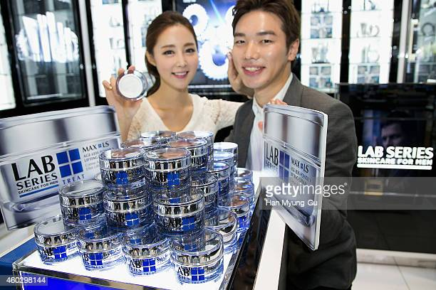 Models pose for media during the launch event for Lab Series Max LS AgeLess Power V Lifting Cream at Lotte Hotel on December 11 2014 in Seoul South...
