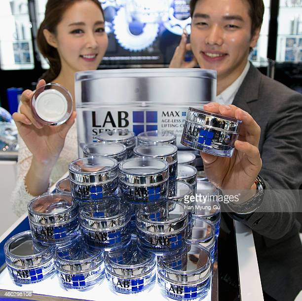 Models pose for media during the launch event for the Lab Series Max LS AgeLess Power V Lifting Cream at Lotte Hotel on December 11 2014 in Seoul...