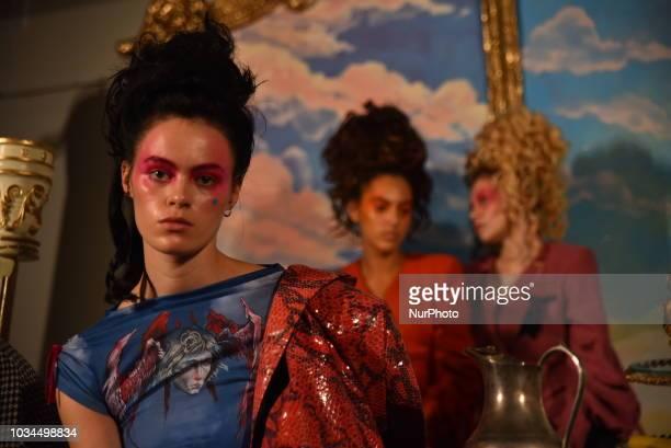 Models pose for photographs at Steve O Smith presentation during London Fashion Week September 2018 London on September 16 2018