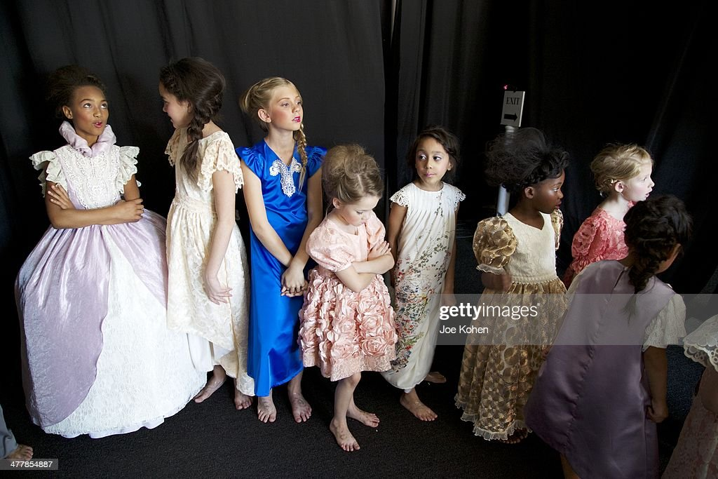 Models pose for photos backstage during day 2 of Style Fashion Week at L.A. Live Event Deck on March 10, 2014 in Los Angeles, California.