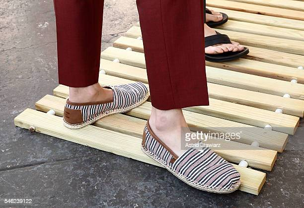 Models pose for photos wearing TOMS shoes during the David Hart Presentation at New York Fashion Week Men's Spring/Summer 2017 at Industria...