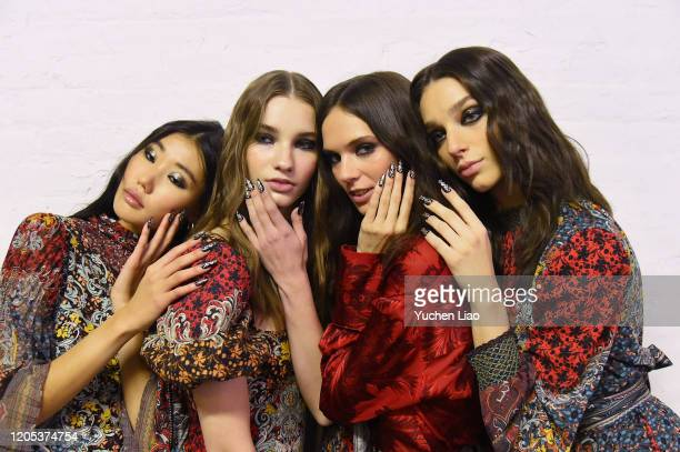 Models pose for the Alice Olivia By Stacey Bendet Presentation during February 2020 New York Fashion Week The Shows on February 10 2020 in New York...