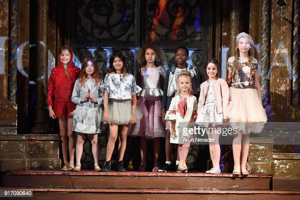 Models pose for the finale of the Monnalisa presentation at New York Fashion Week Powered by Art Hearts Fashion NYFW at The Angel Orensanz Foundation...