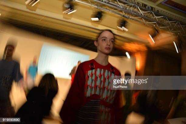 Models pose for the presentation of Cassey Gan collection at Freemasons Hall during London Fashion Week February 2018 London on February 17 2018