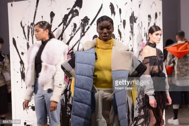 Models pose for the Romeo Hunte collection presentation during New York Fashion Week The Shows on February 11 2017 in New York City