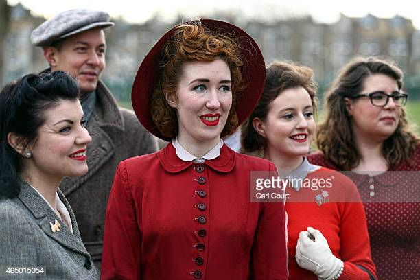 Models pose in 1940s era outfits during a photocall to highlight the forthcoming Fashion on the Ration 1940s Street Style exhibition at the Imperial...