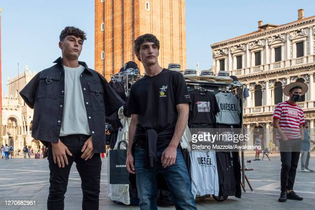 Models pose in Piazza San Marco during the Unforgettable Venice capsule collection by Diesel event during the Venice Film Festival on September 04,...