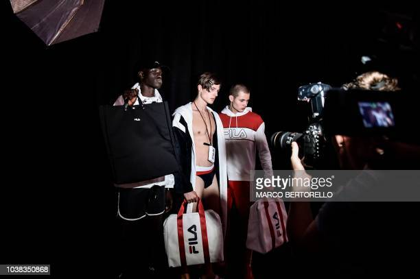 Models pose in the backstage before the Fila fashion show as part of the Women's Spring/Summer 2019 fashion week in Milan on September 23 2018