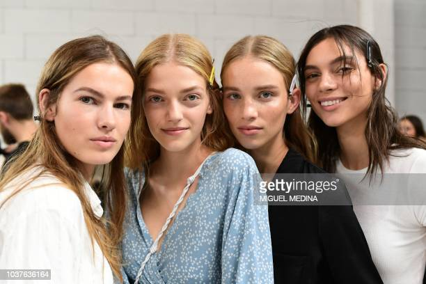 Models pose in the backstage before the presentation of the Roberto Cavalli fashion show during the Women's Spring/Summer 2019 fashion week in Milan...