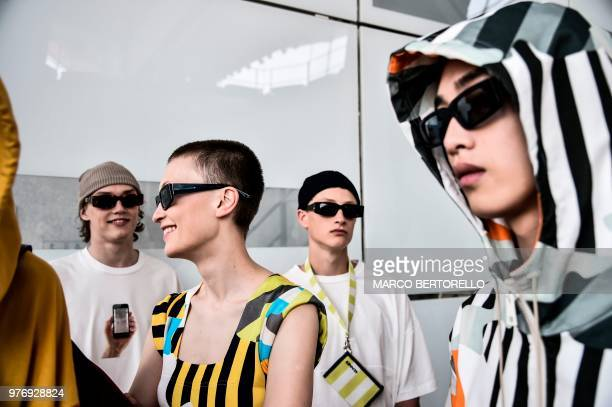 Models pose in the backstage before the show of fashion house Sunnei during the Men's Spring/Summer 2019 fashion shows in Milan on June 17 2018