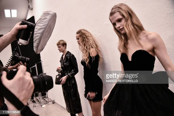 Models pose in the backstage prior to the Blumarine women's Fall/Winter 2019/2020 collection fashion show, on February 22, 2019 in Milan.