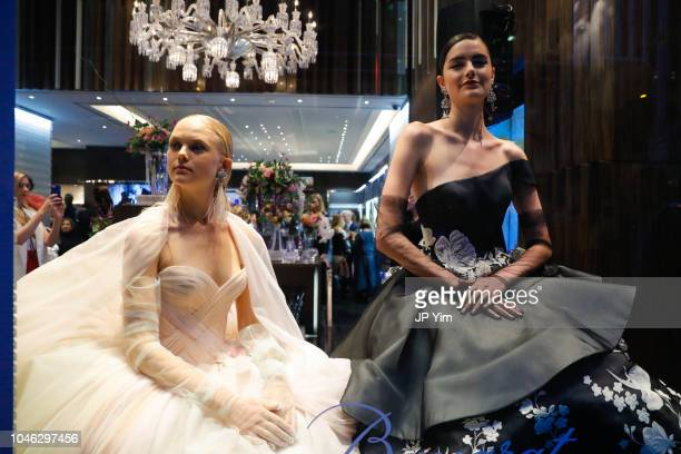 Models pose in the window display at the Baccarat Celebrates designer Ines Di Santo during New York Bridal Fashion Week at the Baccarat Flagship on...