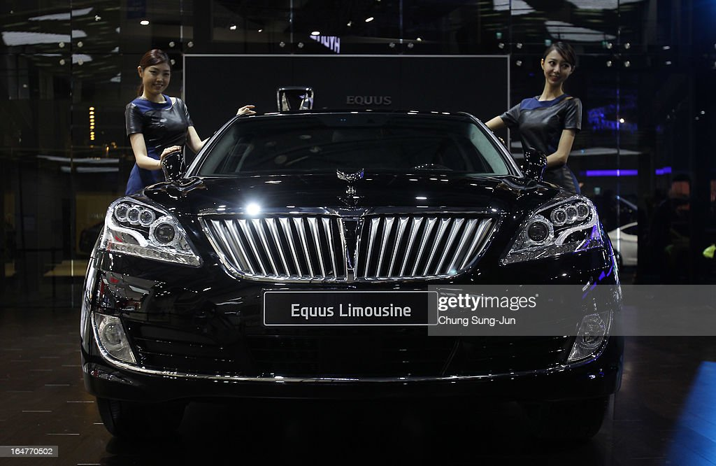 Models pose next to a Hyundai Equus Limousine at the Seoul Motor Show 2013 on March 28, 2013 in Goyang, South Korea. The Seoul Motor Show 2013 will be held in March 29-April 7, featuring state-of-the-art technologies and concept cars from global automakers. The show is its ninth since the first one was held in 1995. About 384 companies from 14 countries, including auto parts manufacturers and tire makers, will set up booths to showcase trends in their respective industries, and to promote their latest products during the show.