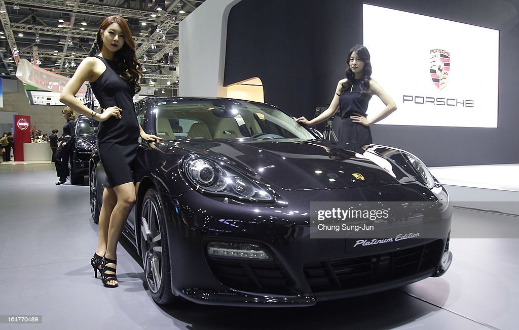 Models pose next to a Porsche Panamera Platium Edition at the Seoul Motor Show 2013 on March 28, 2013 in Goyang, South Korea. The Seoul Motor Show 2013 will be held in March 29-April 7, featuring state-of-the-art technologies and concept cars from global automakers. The show is its ninth since the first one was held in 1995. About 384 companies from 14 countries, including auto parts manufacturers and tire makers, will set up booths to showcase trends in their respective industries, and to promote their latest products during the show.