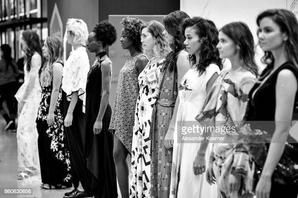 Models pose on runway during the American Women's Club And Esmod Charity Fashion Show at DRIVE Volkswagen Group Forum on October 12 2017 in Berlin...