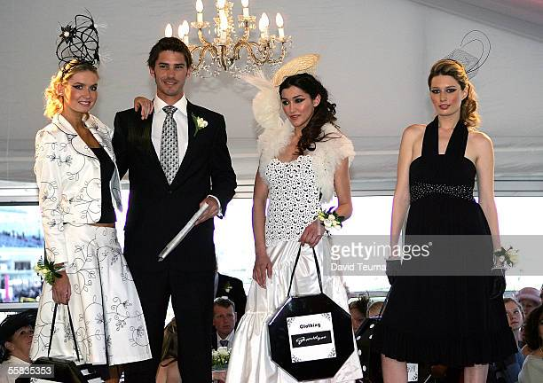 Models pose on stage, Grace wearing a John Cavill design, Jamie wearing a Dom Bagnato design, Silvana wearing a Gwendolynne design and Vanessa...