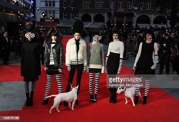 Models pose on the red carpet during the Premiere of 'Frankenweenie' at the opening of the BFI London Film Festival at Odeon Leicester Square on...