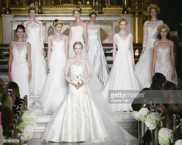 Models pose on the runway at the Atelier Pronovias 2014 Show at St James Church on November 12 2013 in New York City