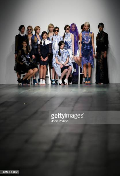 Models pose on the runway at the Bora Aksu show during London Fashion Week Spring Summer 2015 at Somerset House on September 12 2014 in London England