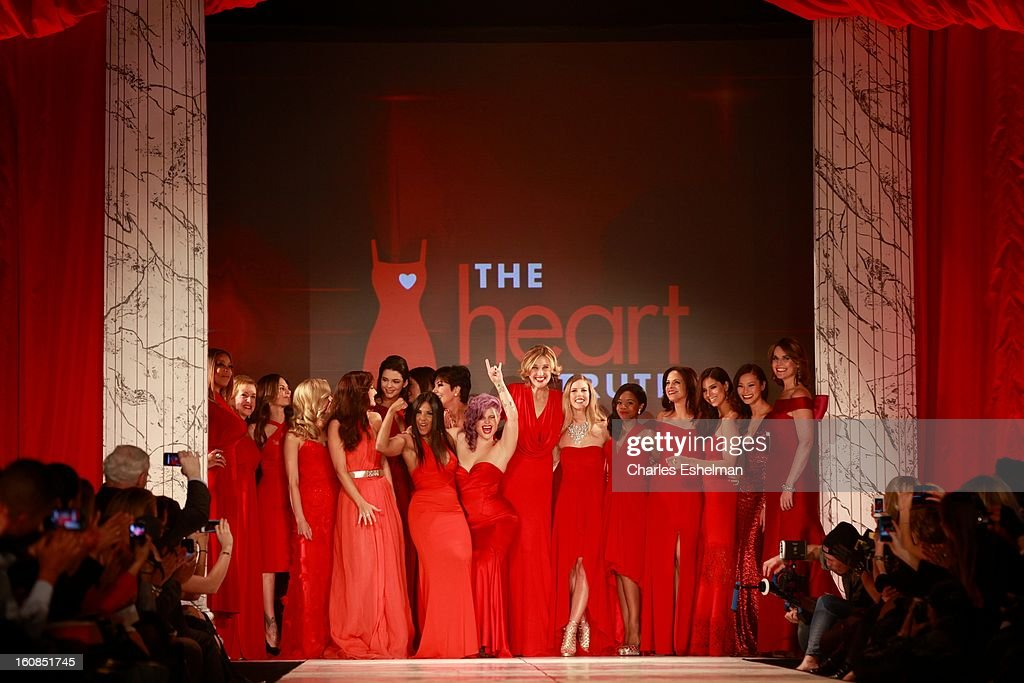 Models pose on the runway at The Heart Truth's Red Dress Collection Fall 2013 Mercedes-Benz Fashion Show at 499 Seventh Avenue on February 6, 2013 in New York City.