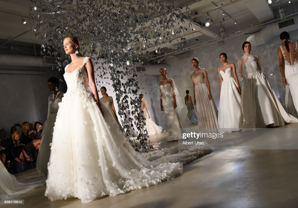 Models pose on the runway at the Justin Alexander FW 2018 Bridal Show during New York Fashion Week Bridal at Venue 57 on October 6, 2017 in New York City.