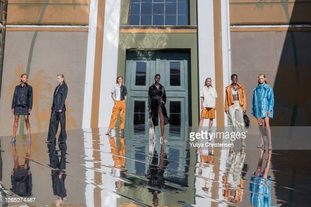 Models pose on the runway at the presentation for Remain Birger Christensen during Copenhagen Fashion Week Spring/Summer 2021 on August 11, 2020 in...