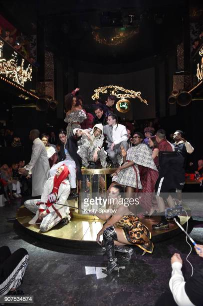 Models pose on the runway during the Andrea Crews Menswear Fall/Winter 20182019 show as part of Paris Fashion Week on January 20 2018 in Paris France