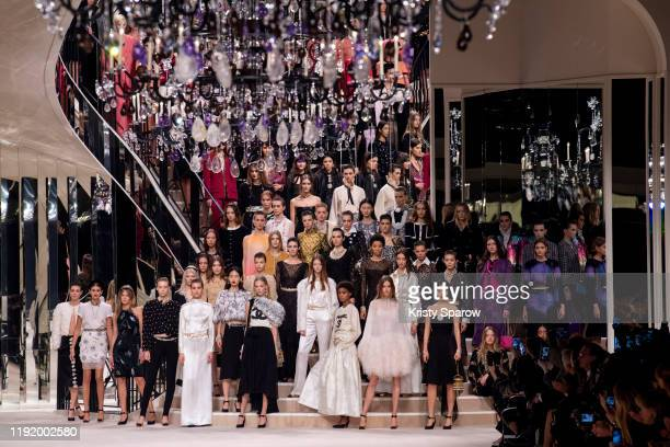 Models pose on the runway during the Chanel Metiers d'Art 2019-2020 show finale at Le Grand Palais on December 04, 2019 in Paris, France.