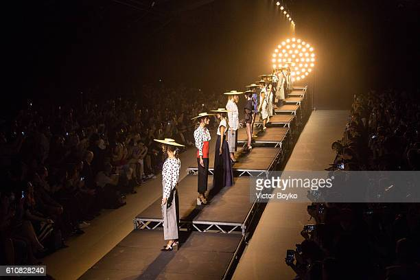 Models pose on the runway during the finale of the Jacquemus show as part of the Paris Fashion Week Womenswear Spring/Summer 2017 on September 27...