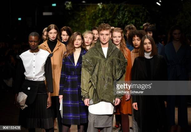 Models pose on the runway during the Greenshowroom Ethical Fashion Show Berlin at Kraftwerk Mitte on January 17 2018 in Berlin Germany