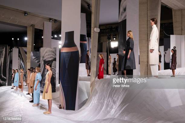 Models pose on the runway during the Hermes Womenswear Spring/Summer 2021 show as part of Paris Fashion Week on October 03, 2020 in Paris, France.