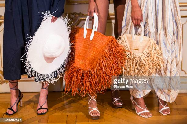 Models pose on the runway during the Jacquemus show at the Italy embassy as part of the Paris Fashion Week Womenswear Spring/Summer 2019 on September...