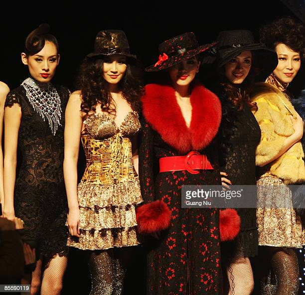 Models pose on the runway during the JudyGalaxy Fashion Collection at the China Fashion Week Autumn/Winter Collection 2009 on March 25 2009 in...