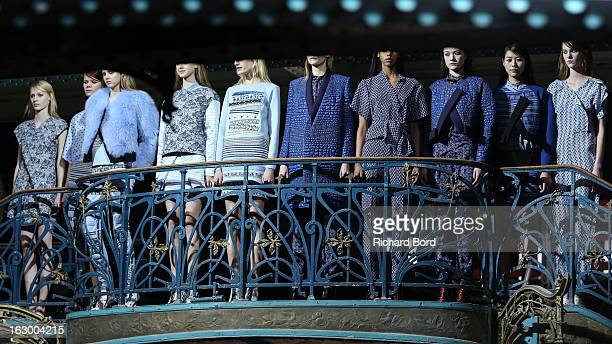 Models pose on the runway during the Kenzo Fall/Winter 2013 ReadytoWear show as part of Paris Fashion Week at La Samaritaine on March 3 2013 in Paris...