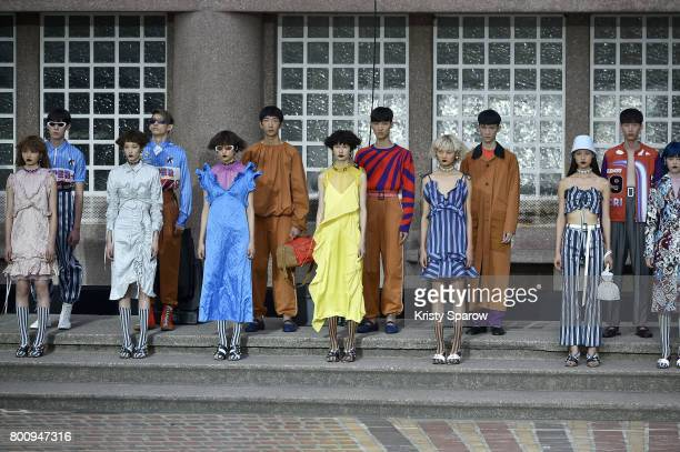 Models pose on the runway during the Kenzo Menswear Spring/Summer 2018 show as part of Paris Fashion Week on June 25 2017 in Paris France
