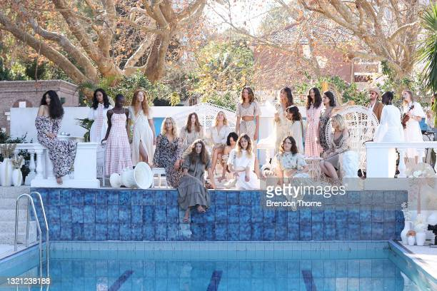 Models pose on the runway during the We Are Kindred show during Afterpay Australian Fashion Week 2021 Resort '22 Collections at Villa Orme on June...