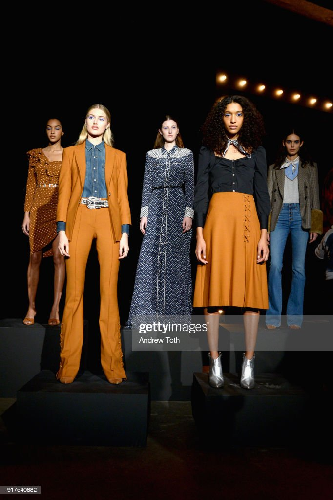 Models pose on the runway for the Veronica Beard Fall 2018 presentation at Highline Stages on February 12, 2018 in New York City.