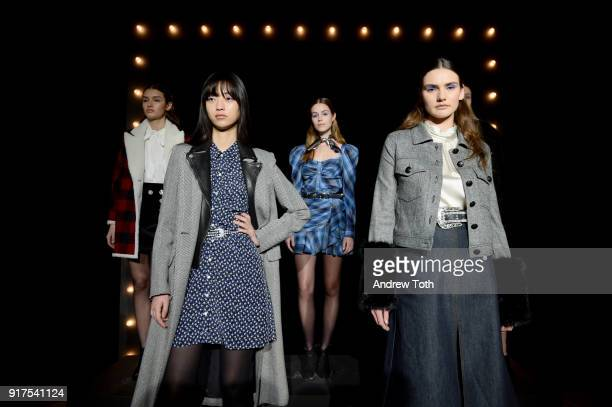 Models pose on the runway for the Veronica Beard Fall 2018 presentation at Highline Stages on February 12 2018 in New York City
