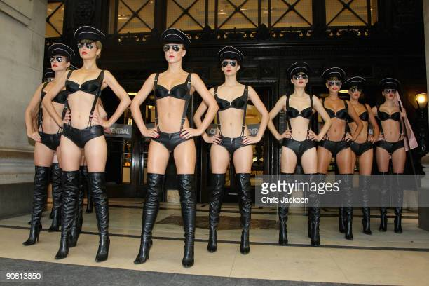 Models pose outside Selfridges during a photocall for lingerie brand Agent Provocateur's new 'AP Love Force' range on September 16 2009 in London...
