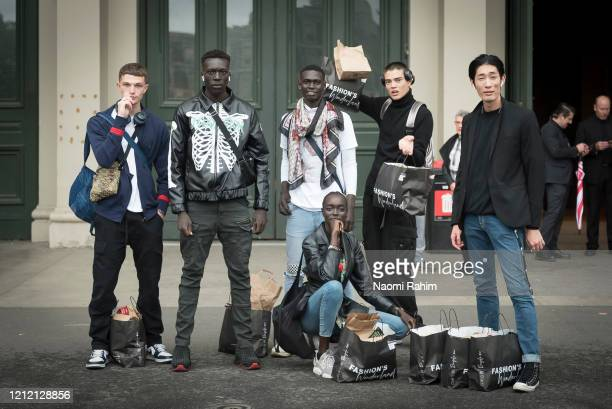 Models pose outside the Royal Exhibition Building on March 13 2020 in Melbourne Australia Melbourne Fashion Festival organisers announced on Friday...