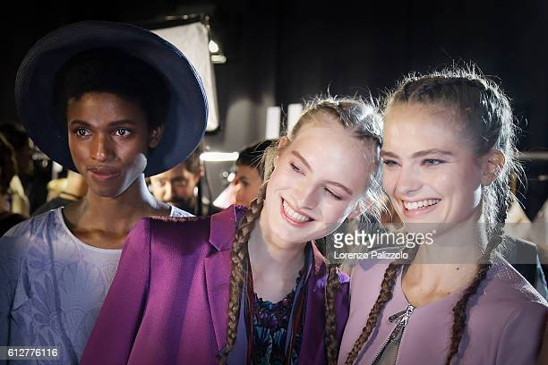Models pose prior the Emporio Armani show as part of the Paris Fashion Week Womenswear Spring/Summer 2017 on October 3 2016 in Paris France
