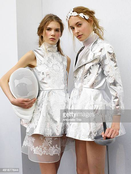 Models pose prior the Moncler Gamme Rouge show as part of the Paris Fashion Week Womenswear Spring/Summer 2016 on October 7 2015 in Paris France
