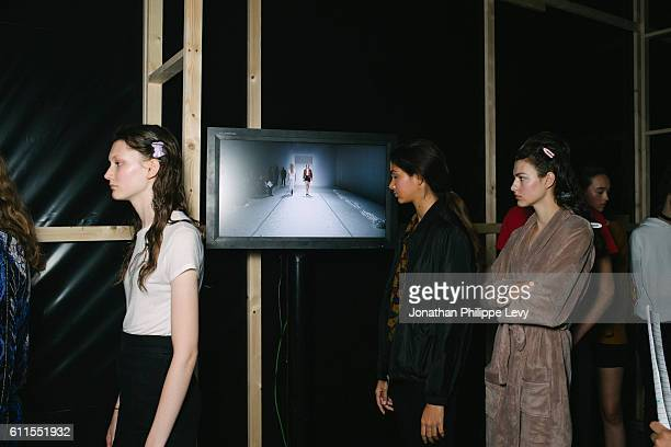 Models pose prior to the Chalayan show as part of the Paris Fashion Week Womenswear Spring/Summer 2017 on September 30 2016 in Paris France