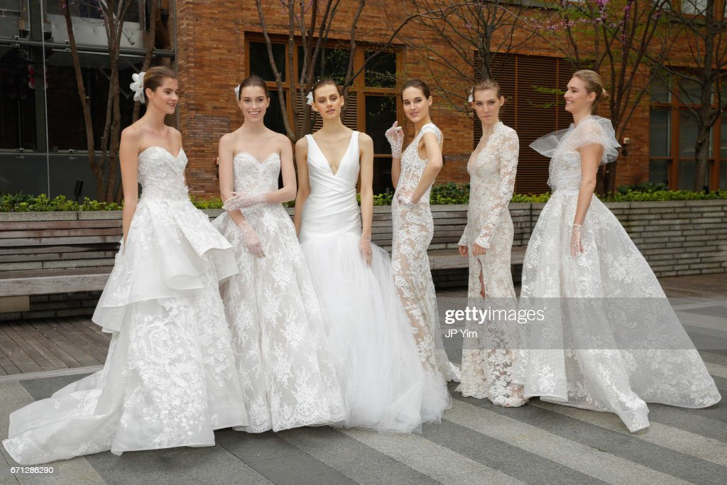Models pose prior to the Monique Lhuillier Spring 2018 Bridal show at Carnegie Hall on April 21, 2017 in New York City.